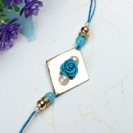 Blue Rose with Pearl Rakhi QAT