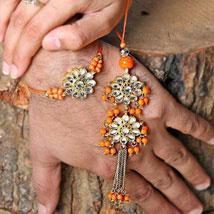 Orange Kundan Lumba Set: Send Bhaiya Bhabhi Rakhi to UAE